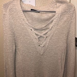 Light tan bell sleeve cross-cross sweater LG